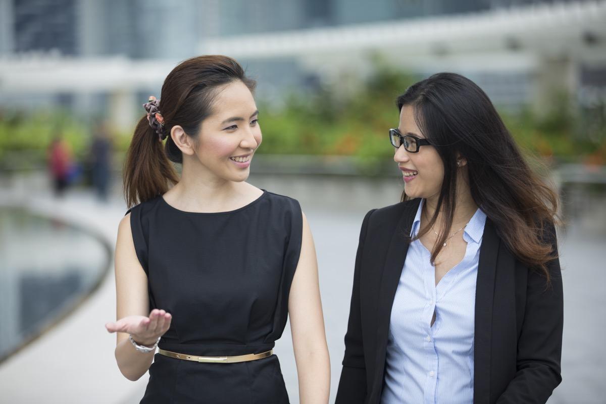 two young asian women working outdoors