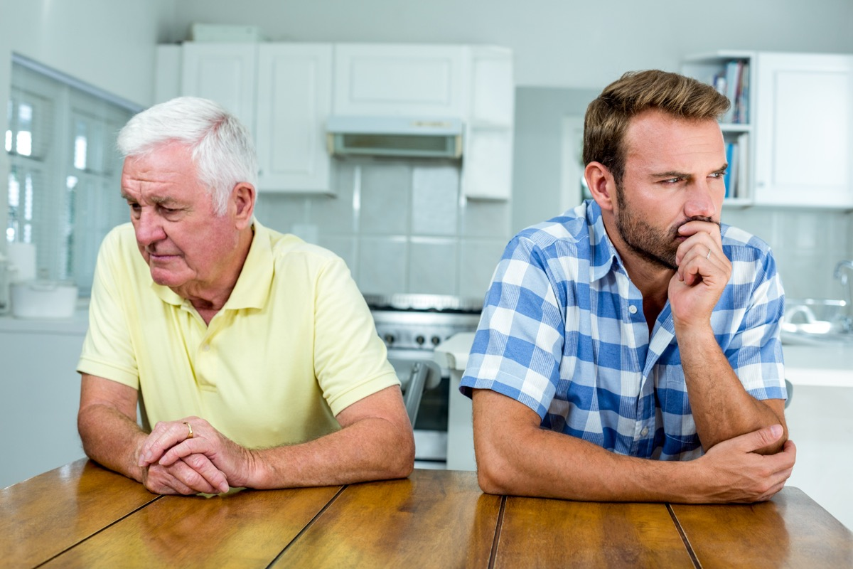 upset white father and adult son