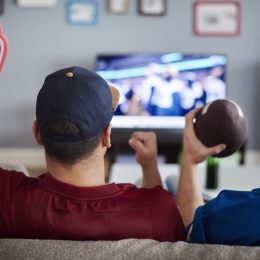 Two men watching the Super Bowl on TV