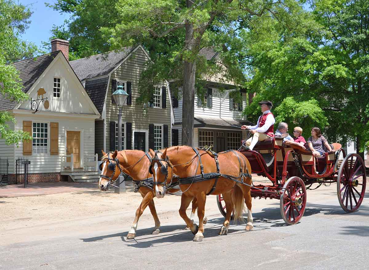 a horse and carriage of tourists in colonial williamsburg