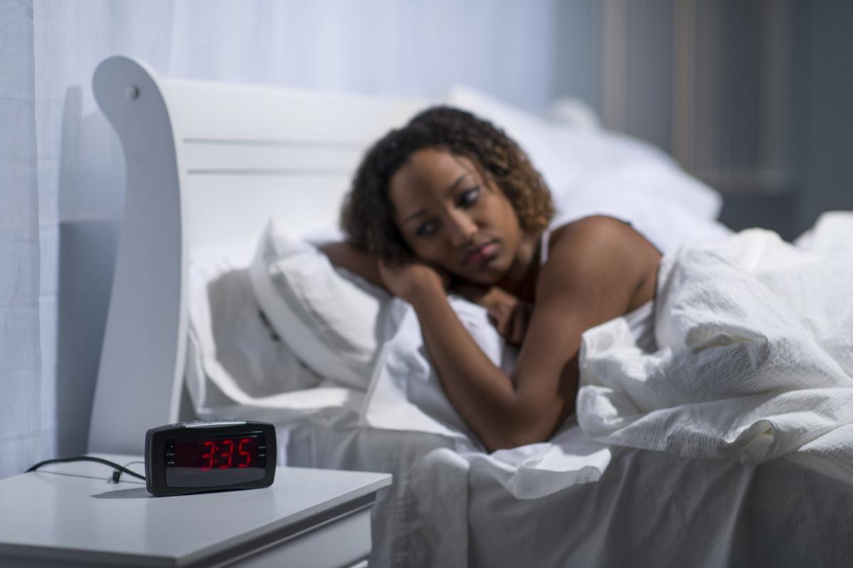 Woman lying awake in bed with sleep apnea or insomnia