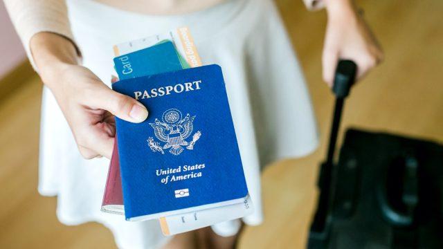 woman holding us passport