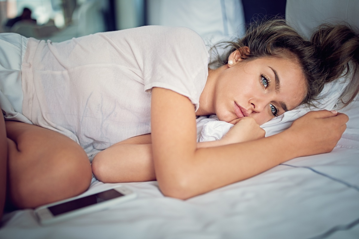 young girl with relationship difficulties. laying sad in her bed