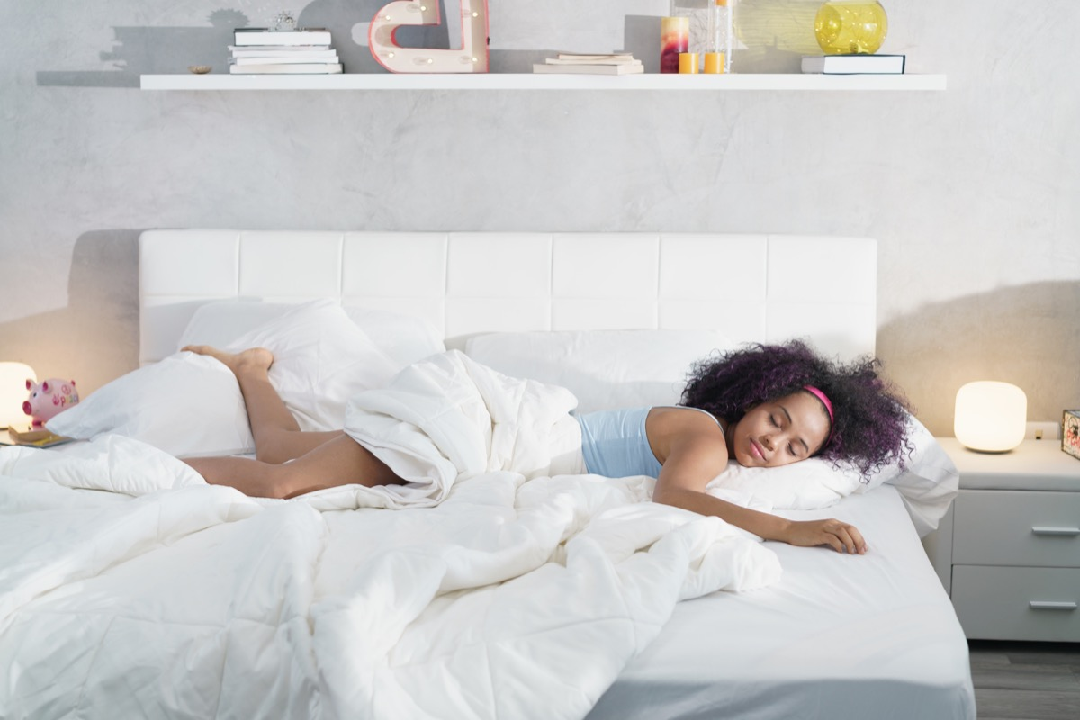 Woman taking up the whole bed sleeping alone