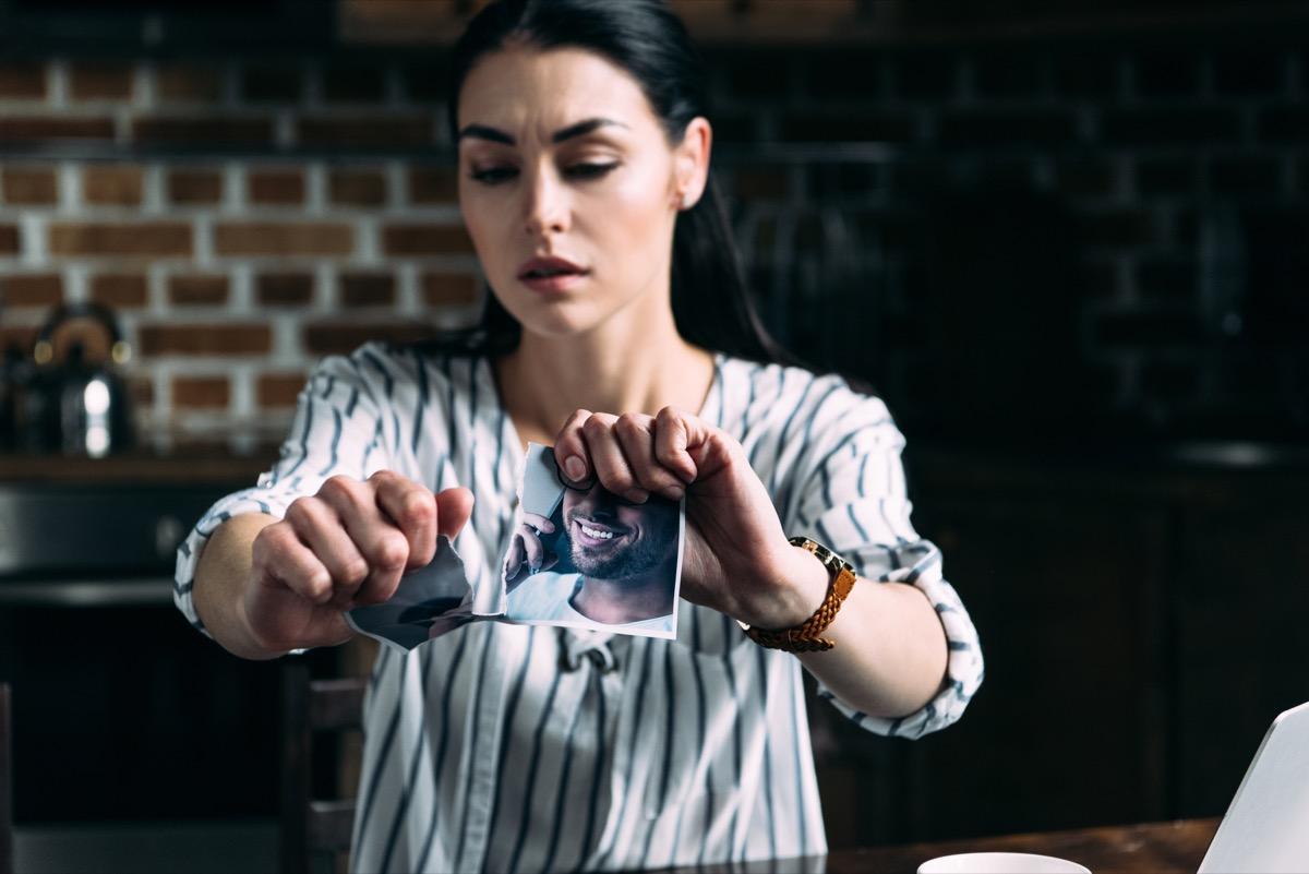 woman tearing a photo