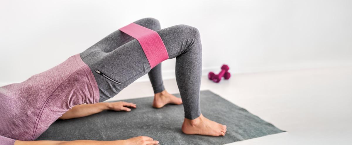 woman training on yoga mat