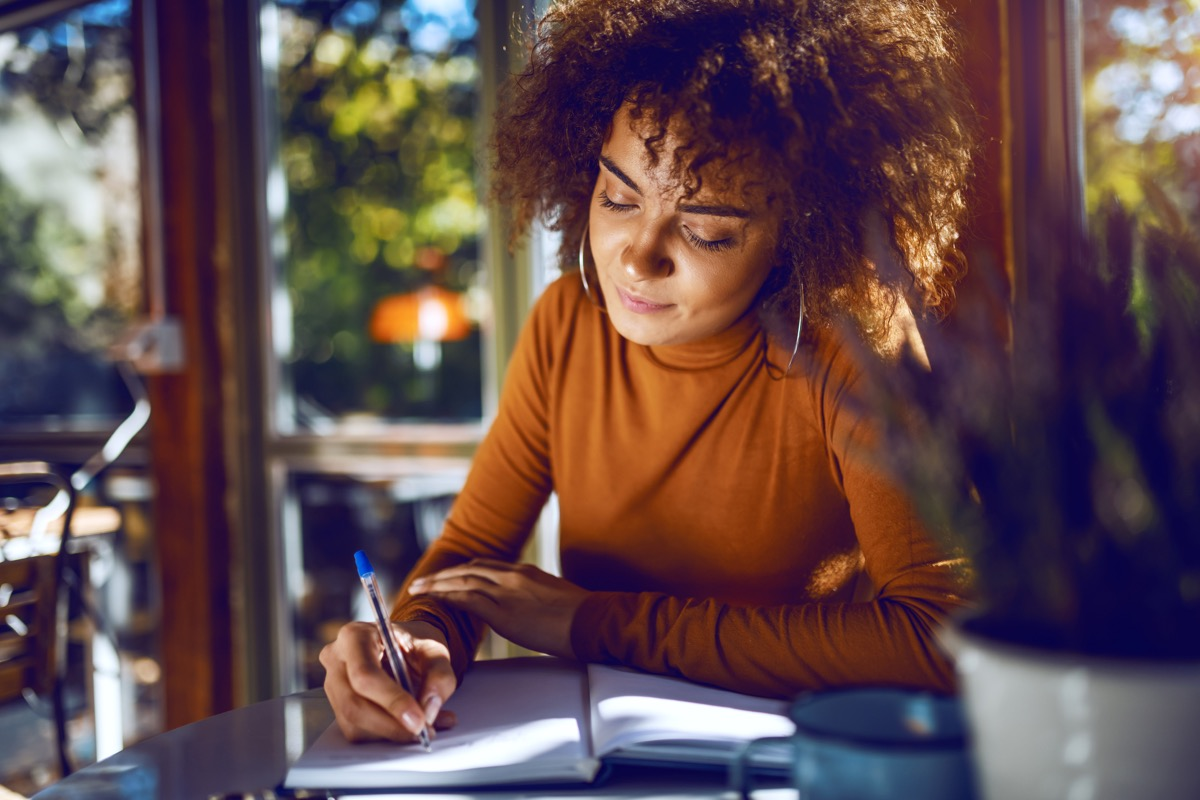 Portrait of cute mixed race student with curly hair and in turtleneck sitting in cafe and studying for exams. (Portrait of cute mixed race student with curly hair and in turtleneck sitting in cafe and studying for exams., ASCII, 110 components, 110 by
