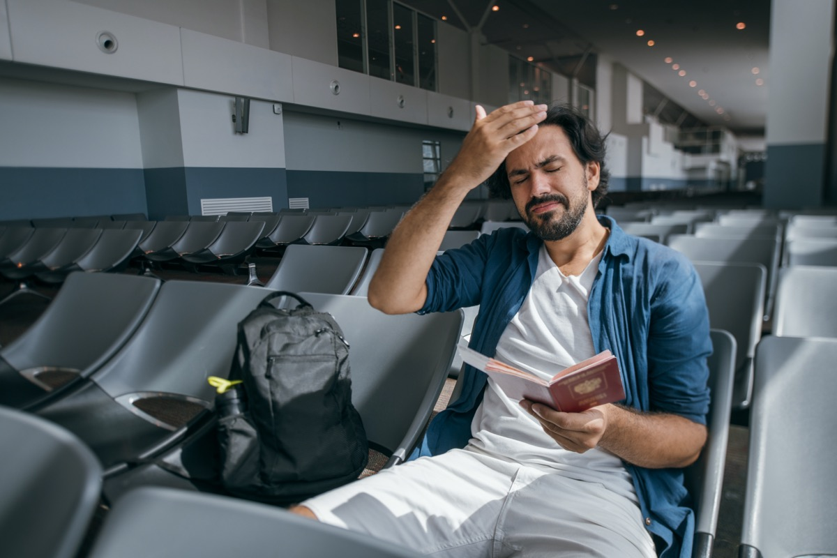 man frustrated for wrong flight details