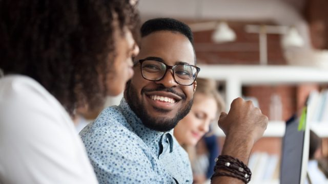 young black man smiling at woman