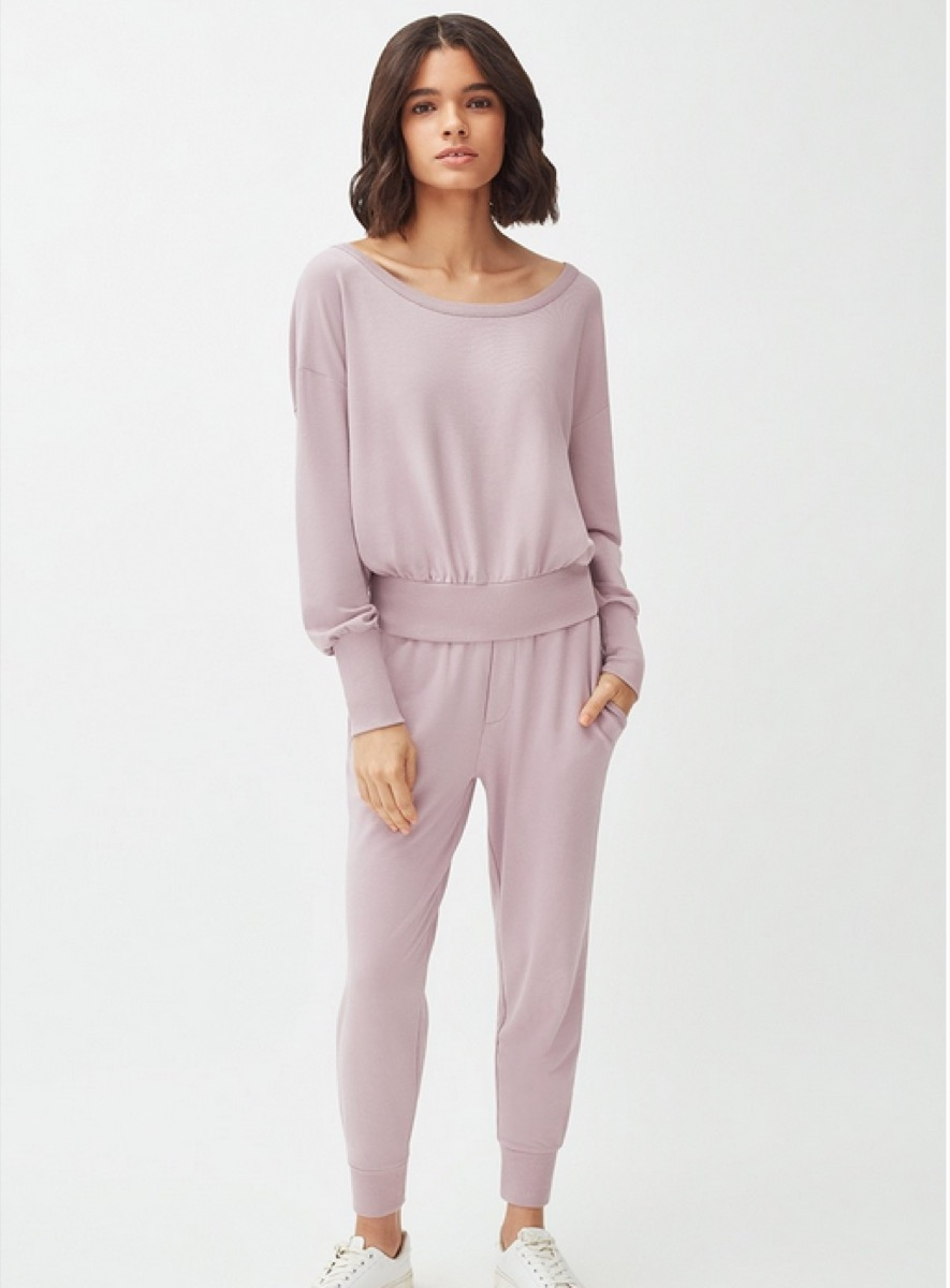 young woman in purple jumpsuit