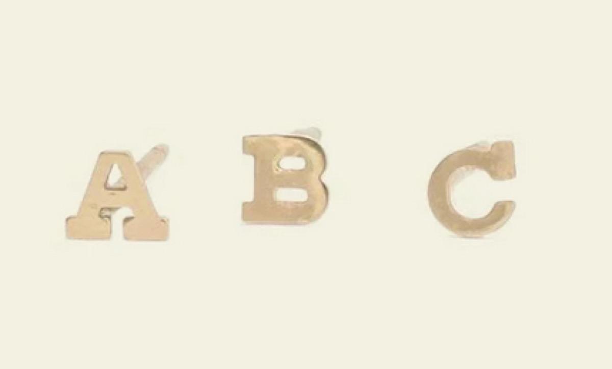 three gold A B C letter stud earrings
