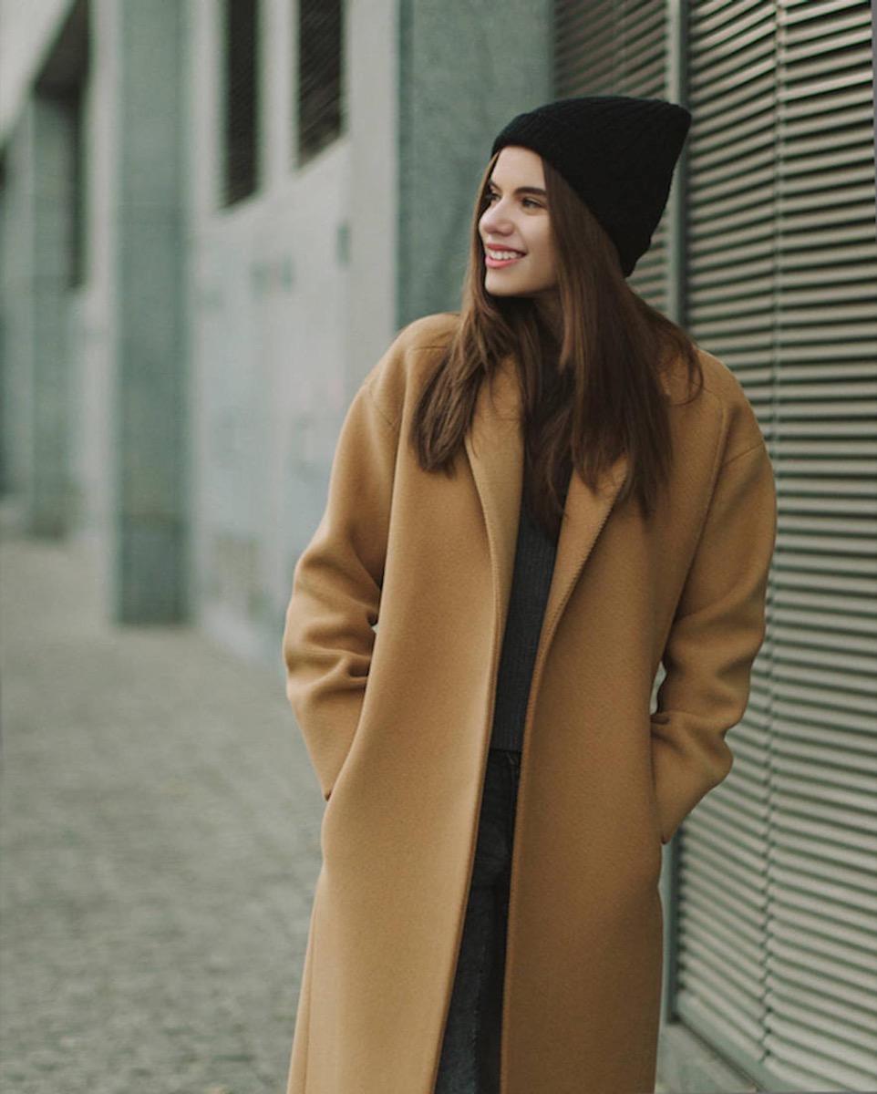 woman in camel coat