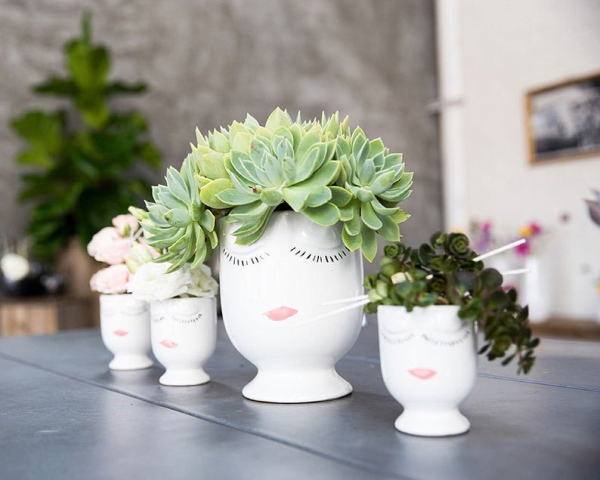 set of four ceramic planters with faces