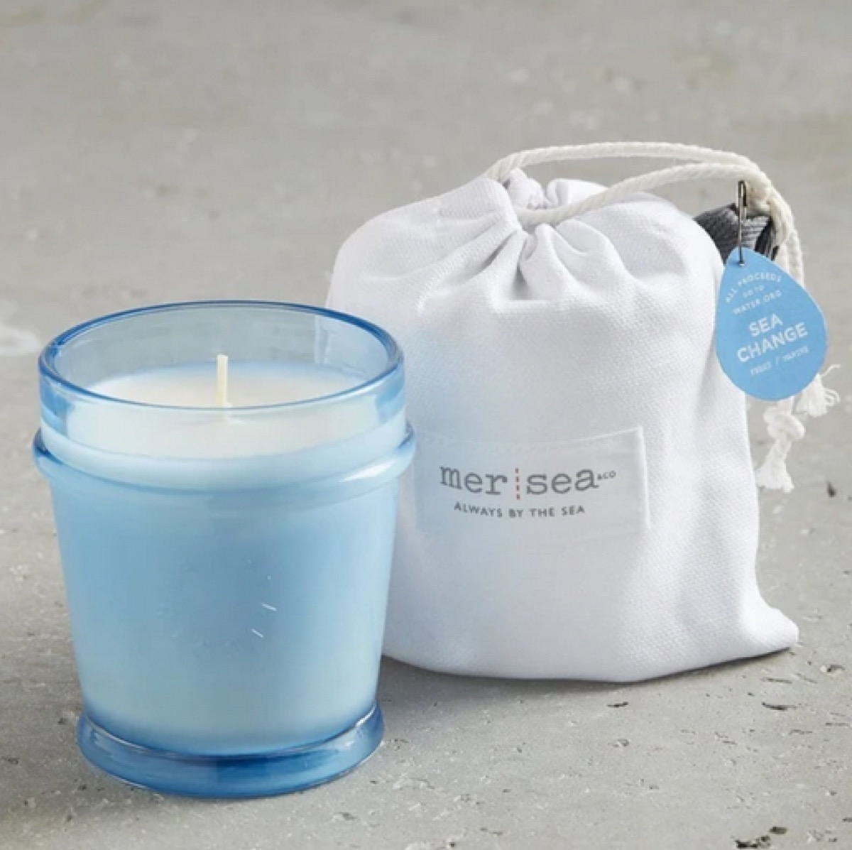 candle in blue glass jar