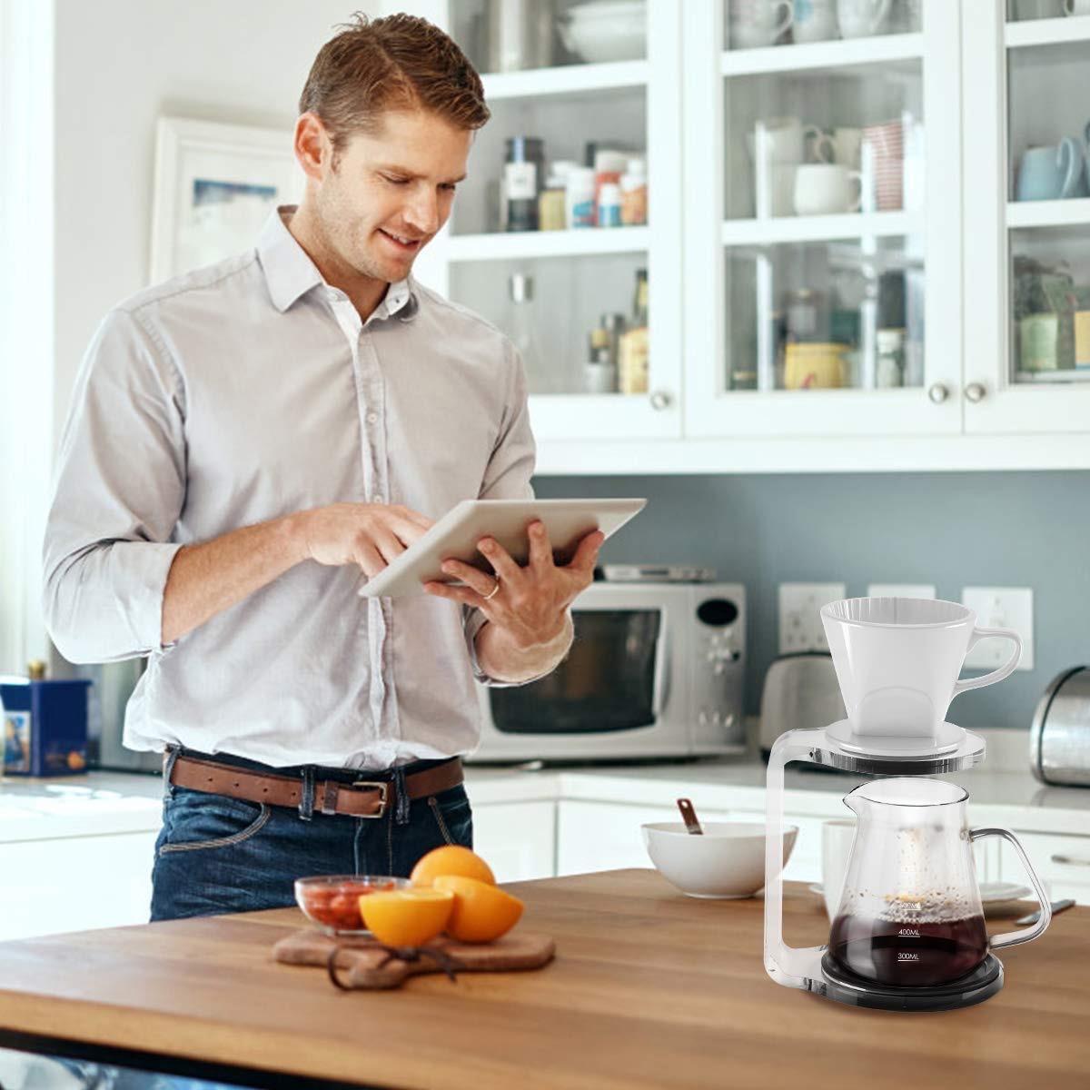 white man standing in kitchen next to coffee maker
