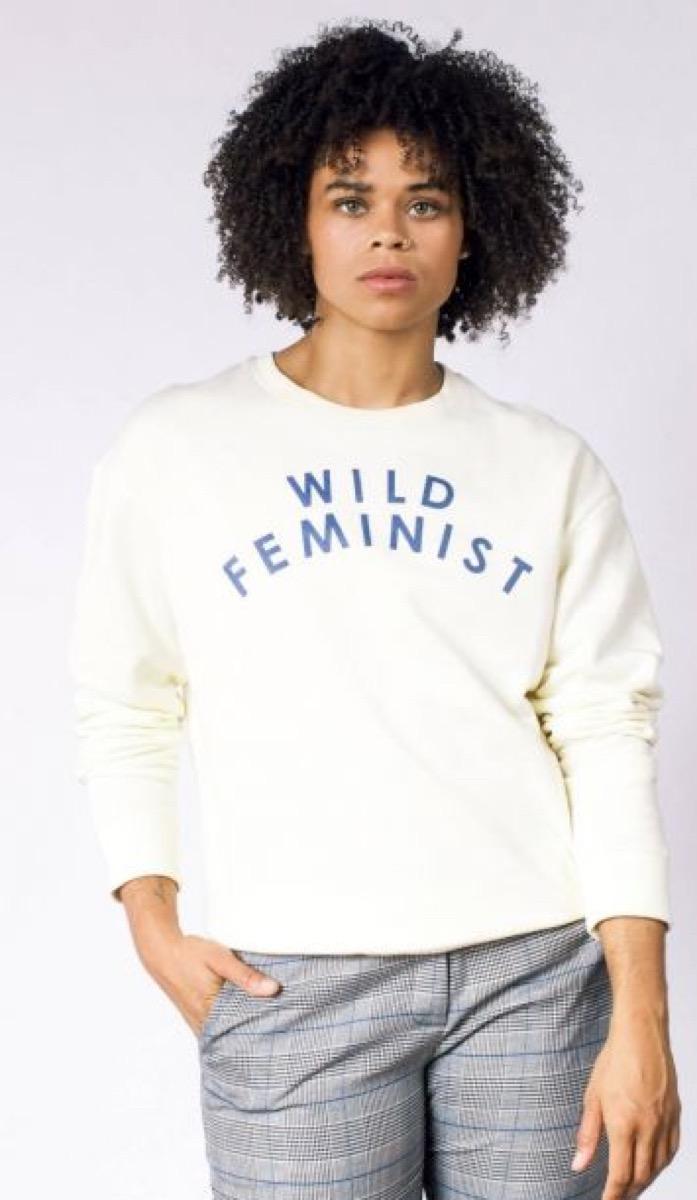 "young black woman in ""wild feminist"" sweatshirt"