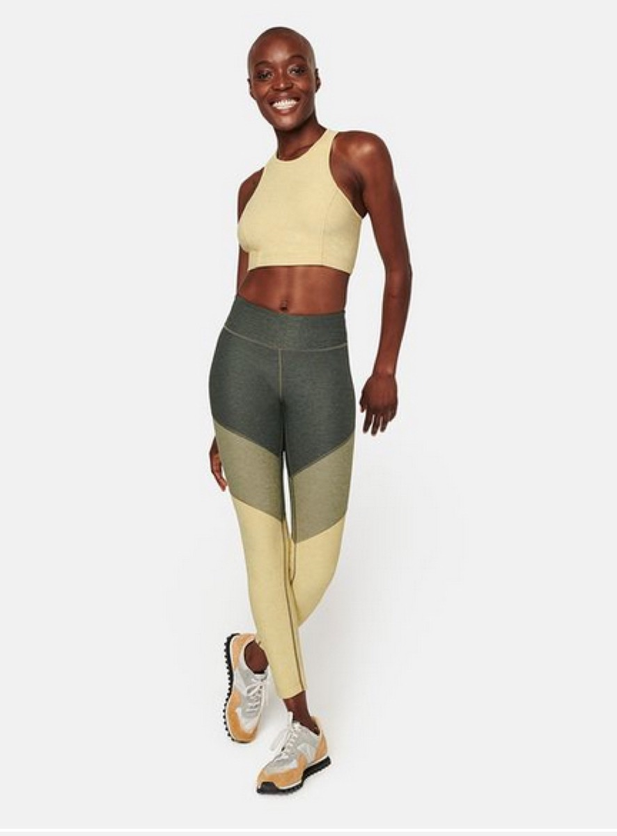 young black woman in leggings and sports bra