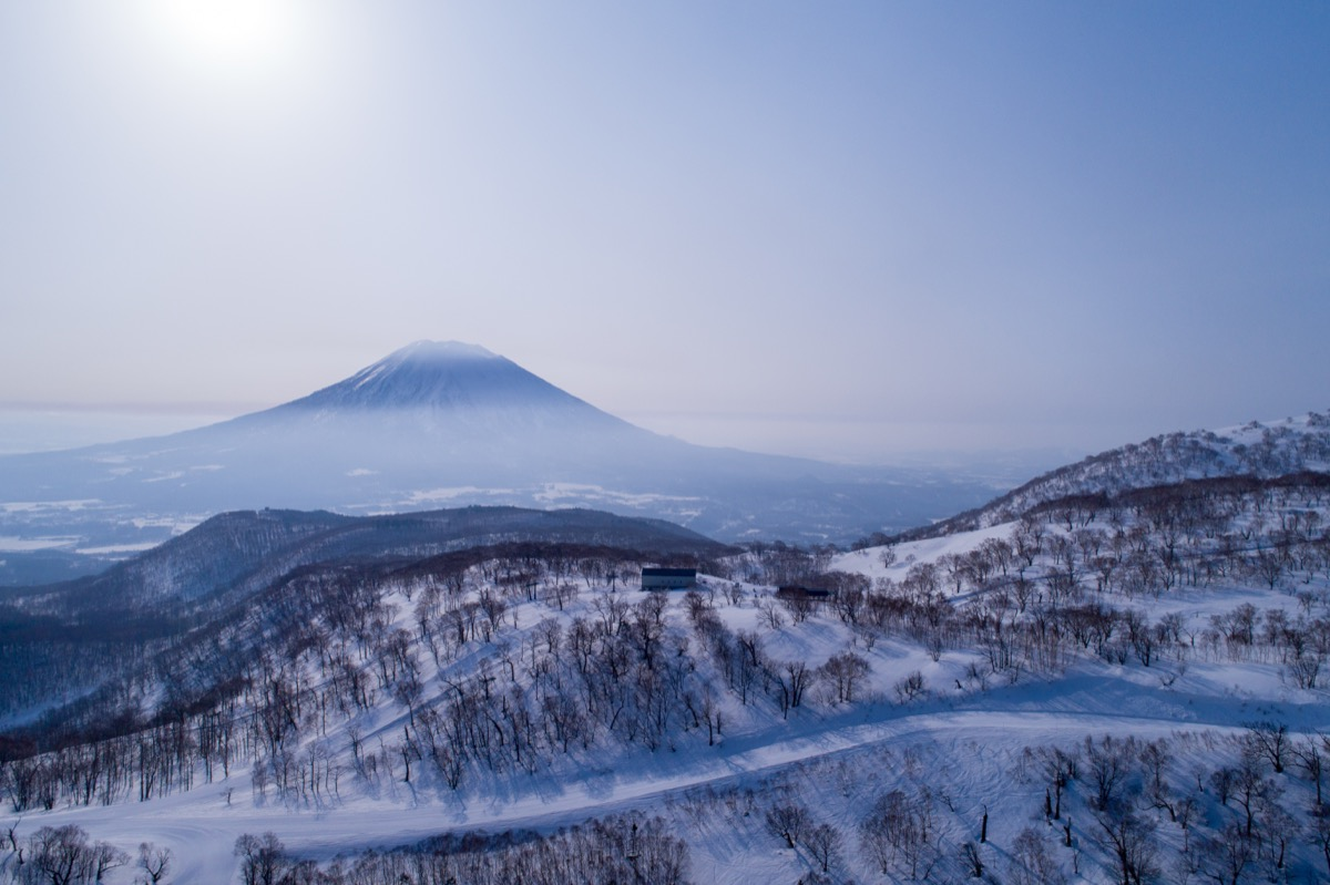 aerial view of the park hyatt hanazono with mt. yotei in the background