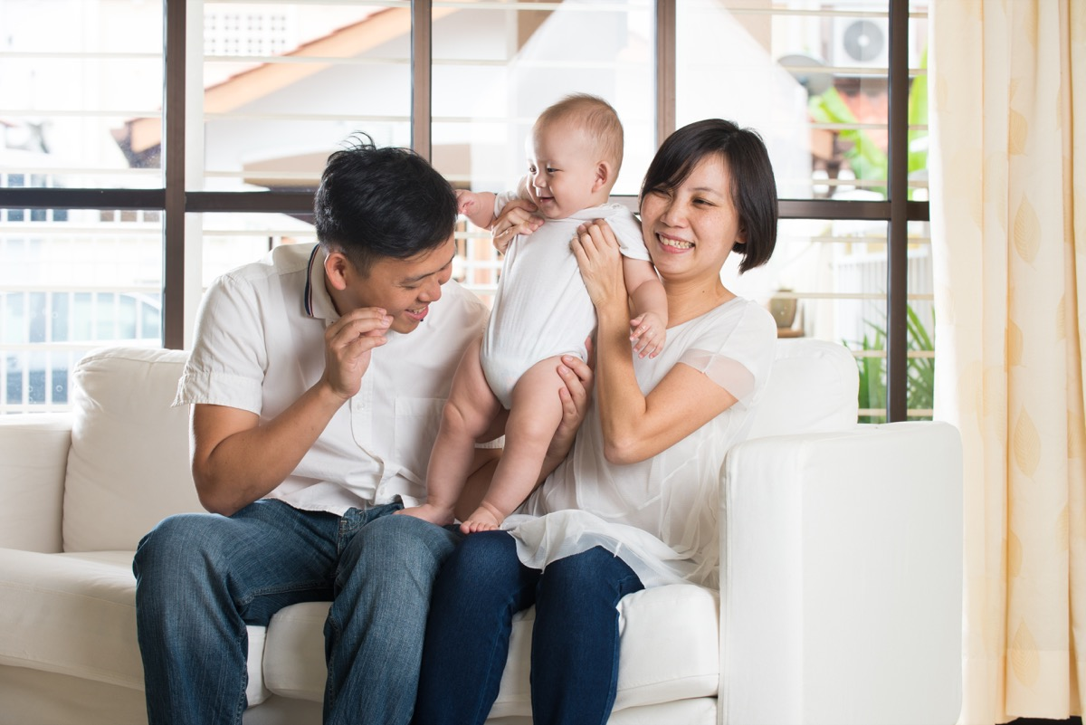 asian parents with young baby