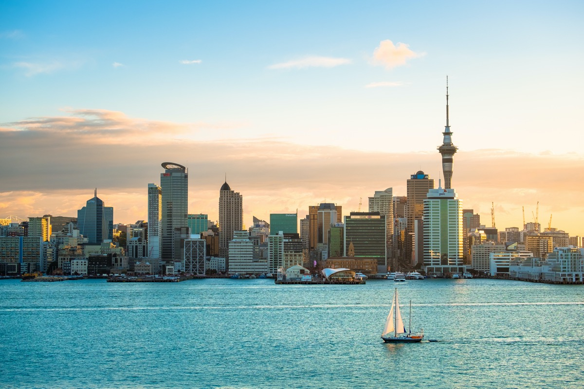 skyline view of the Auckland waterfront with a sailboat