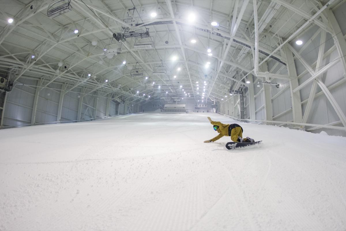 man snowboarding at an indoor ski resort in new jersey