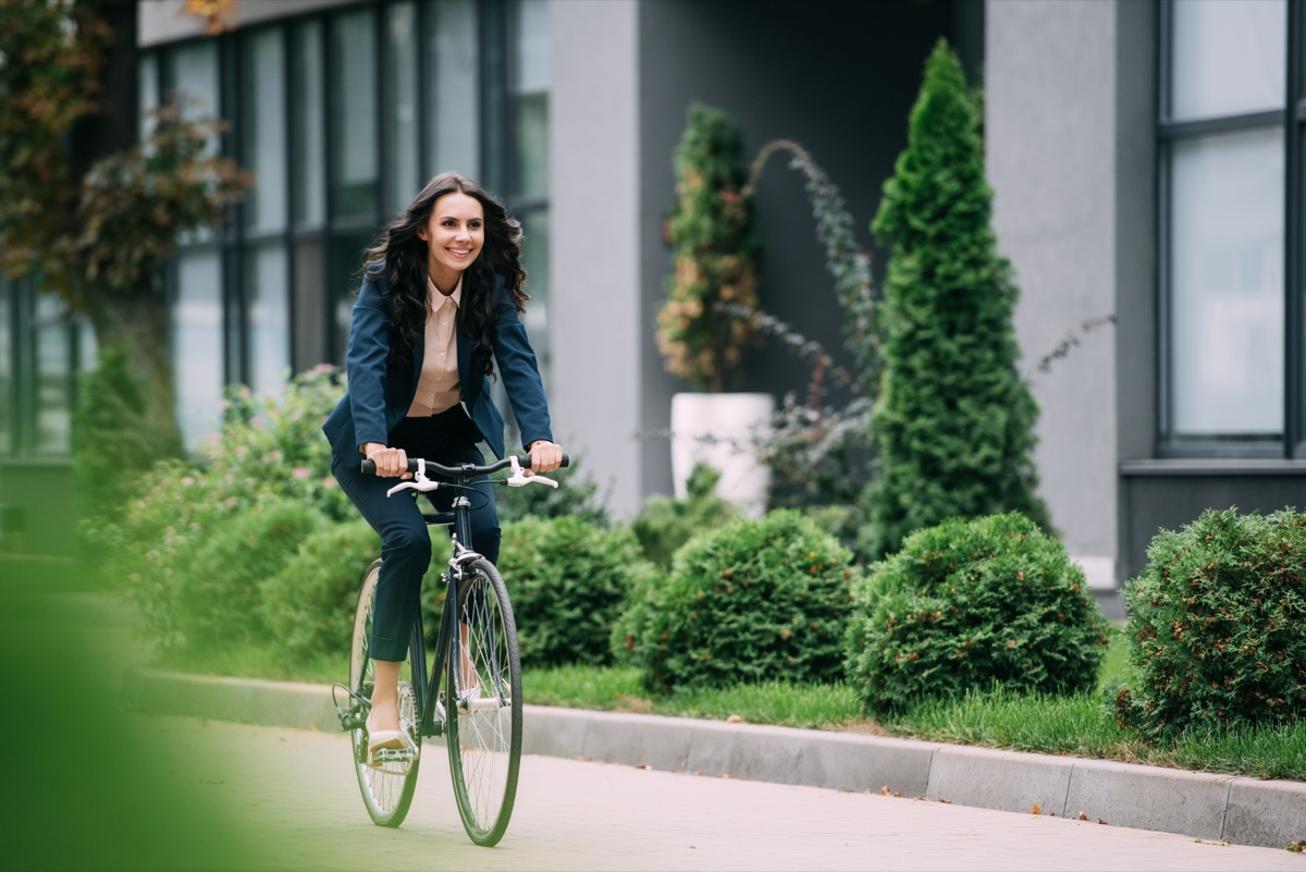 Business woman riding her bike to work