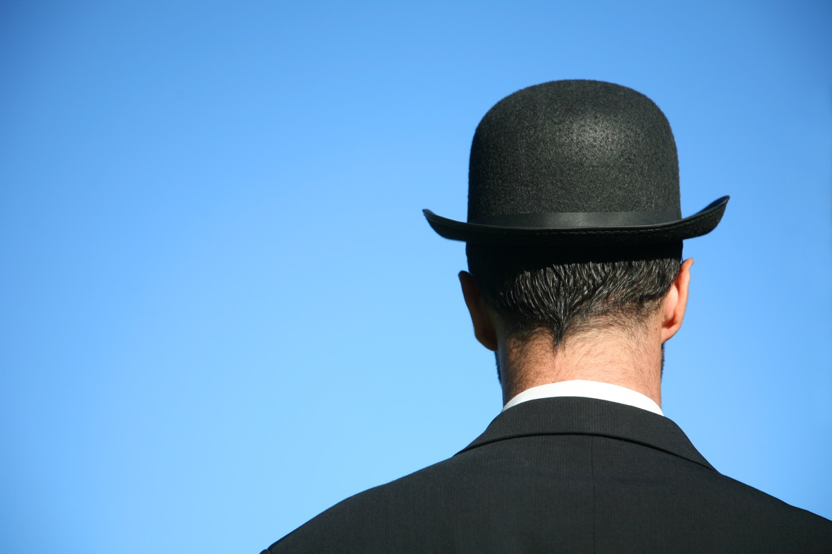 head shot from behind of man with bowler hat