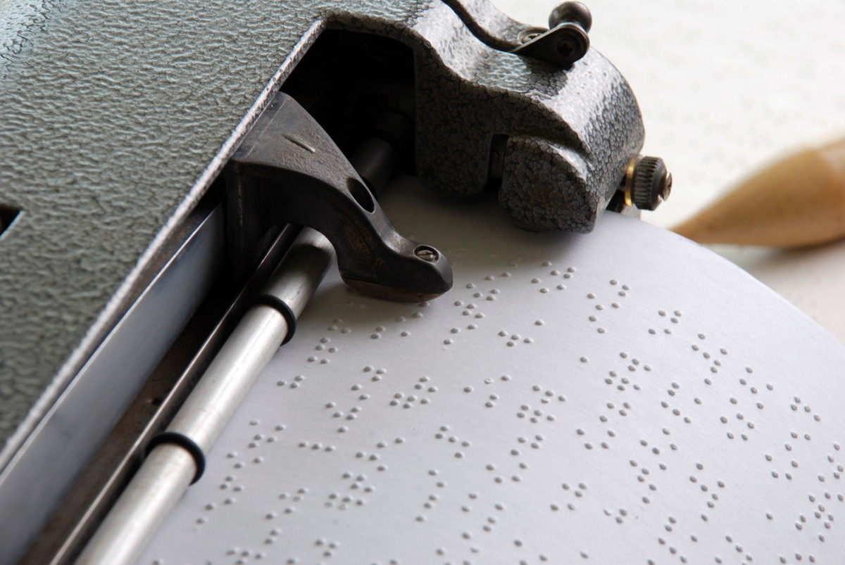 braille reading being printed