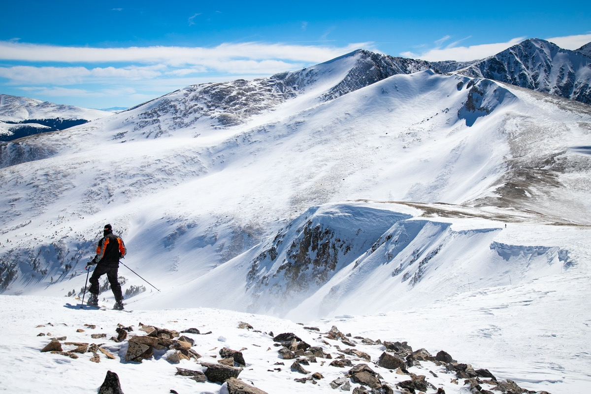 man on top of Breckenridge mountain Peak8
