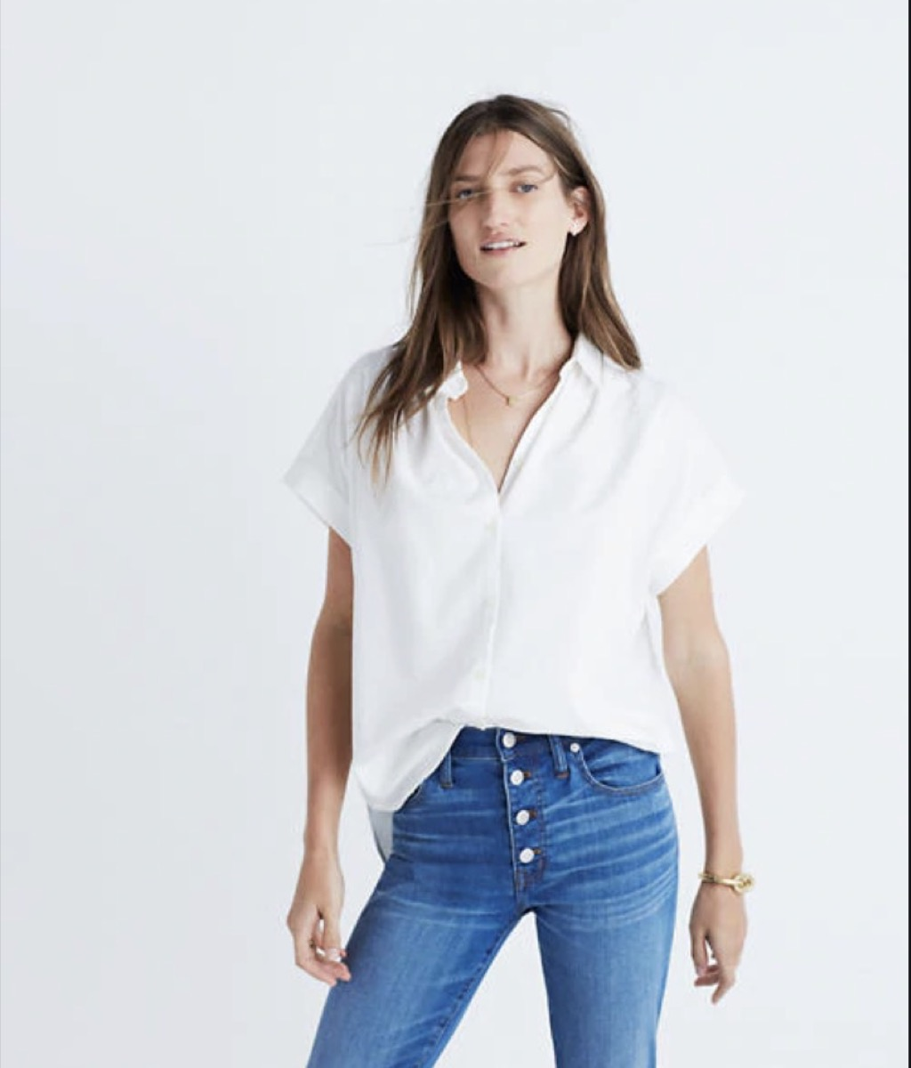 woman in white top and jeans