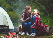 Mother daughter campfire roasting