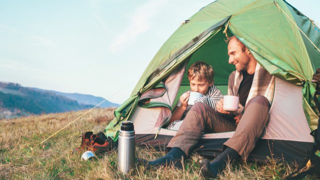 Father son camping in tent