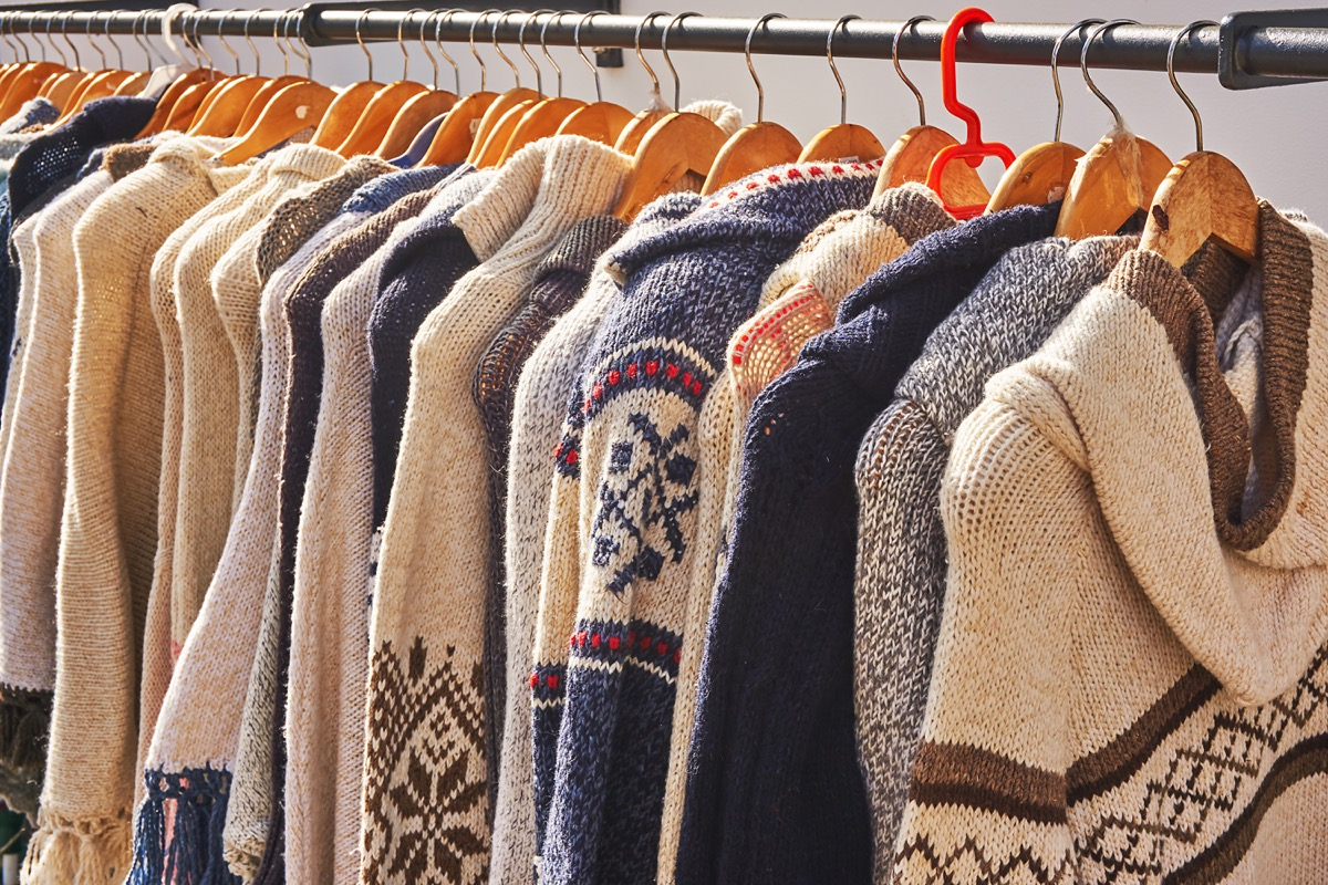 rack of cardigans hung up next to each other