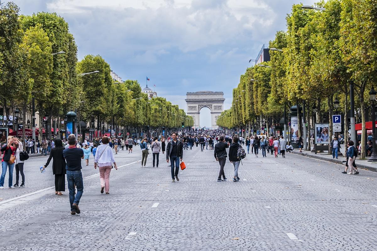 people walking on champ elysees avenue paris