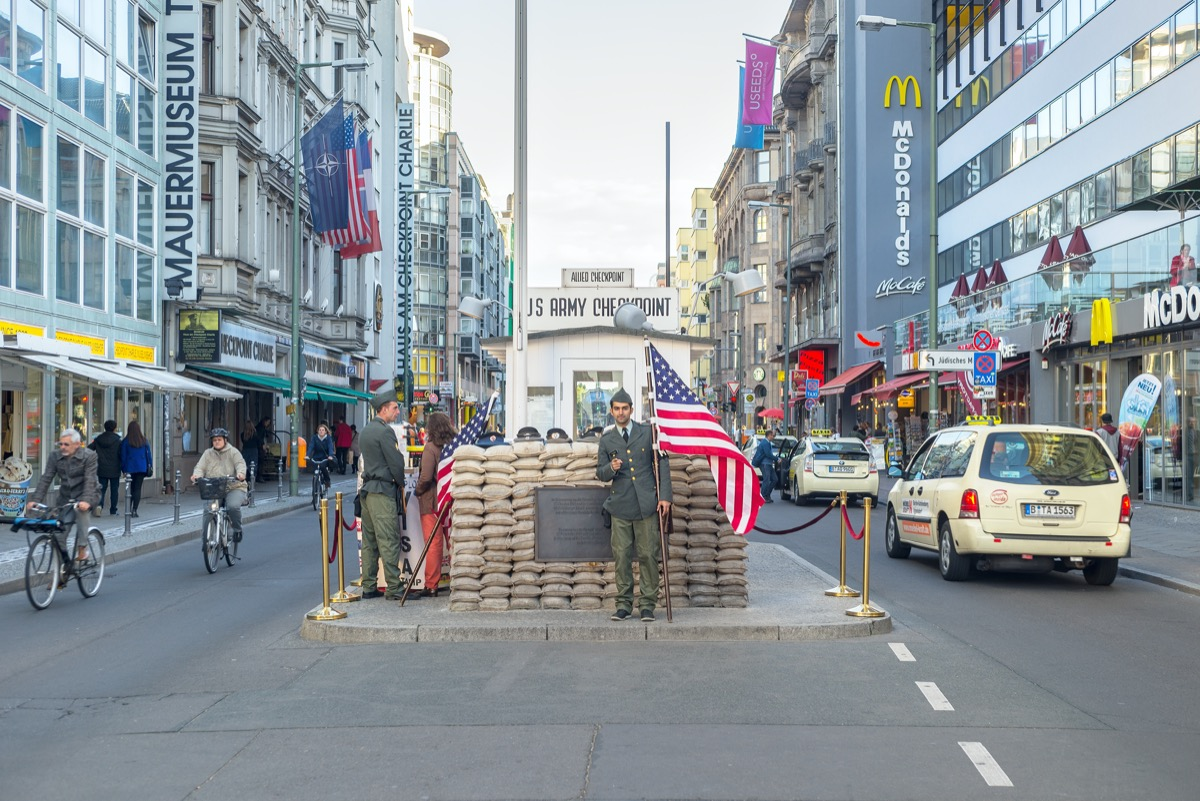 checkpoint charlie in berlin with guards standing by