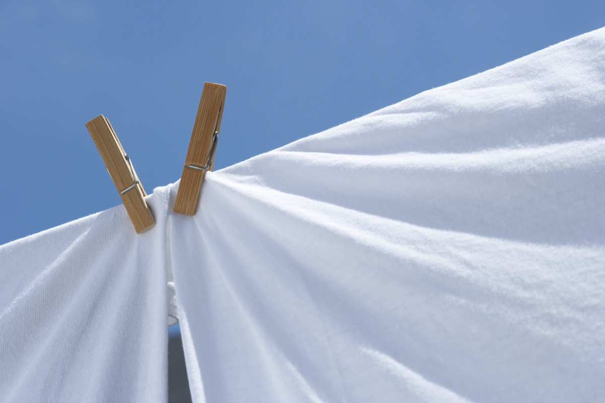 clothes line with two white sheets
