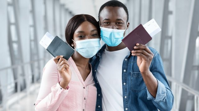Travel,Safe,During,Coronavirus,Pandemic.,Black,Couple,In,Protective,Medical