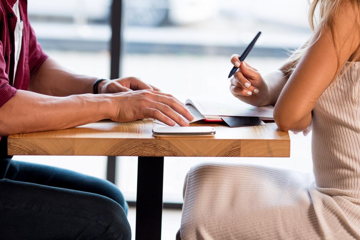 white couple making list