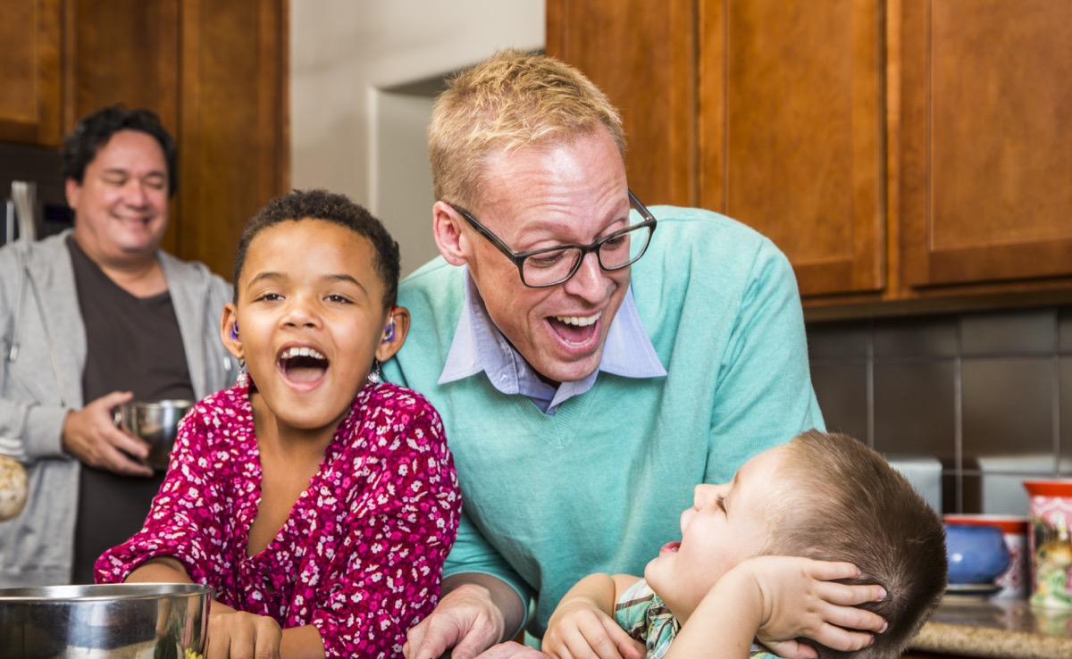 dads laughing in kitchen with kids