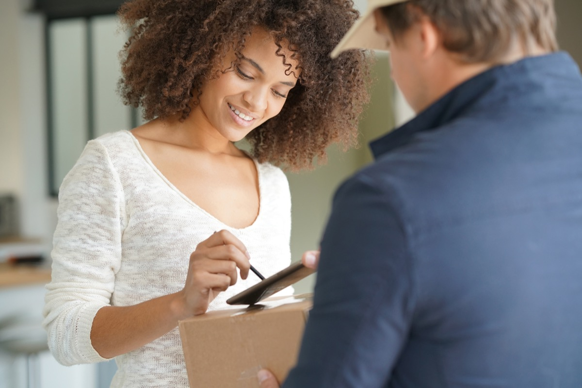 Woman signing for delivery