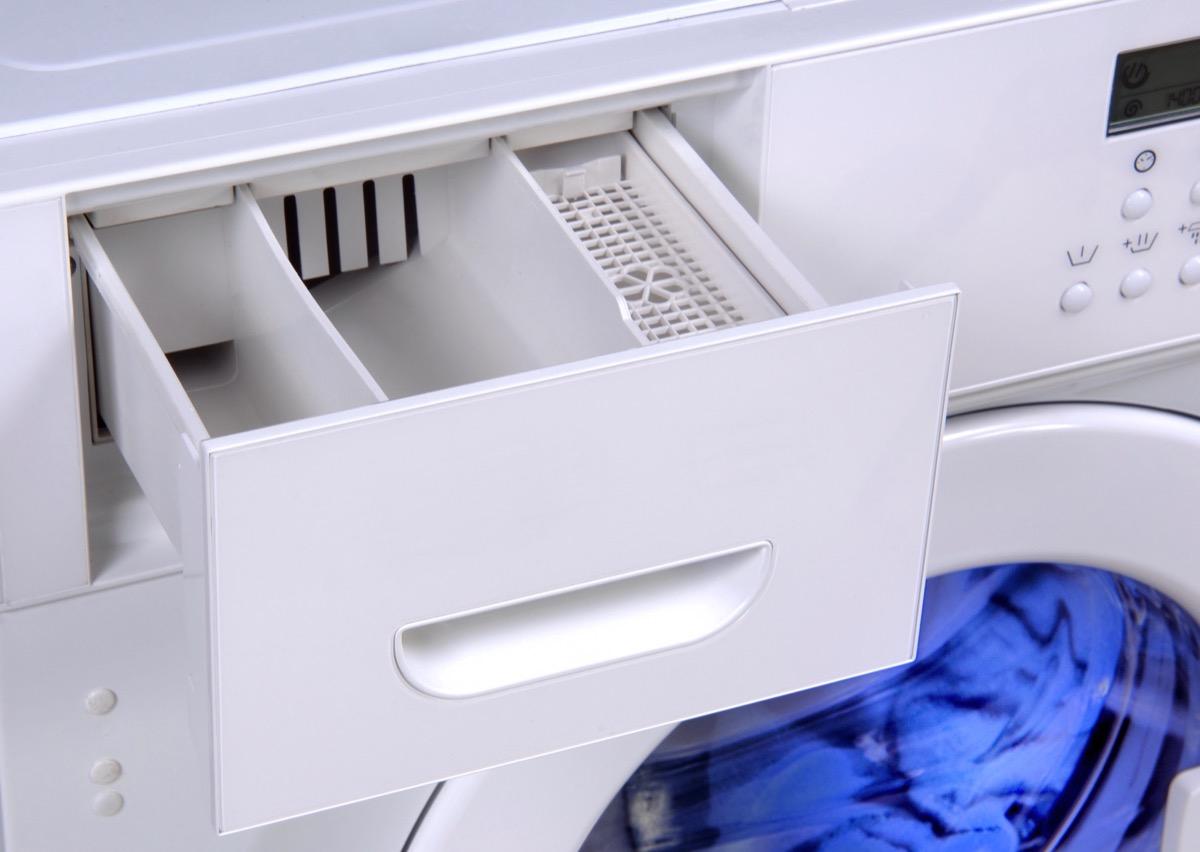 open detergent drawer in washing machine