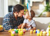 Father and son dyeing Easter eggs