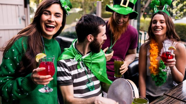 group of 20-something white friends celebrating st. patrick's day