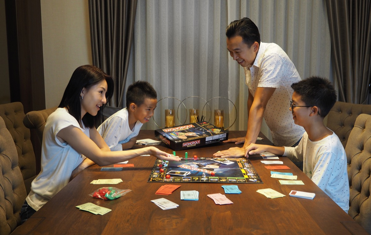Family playing monopoly for family game night