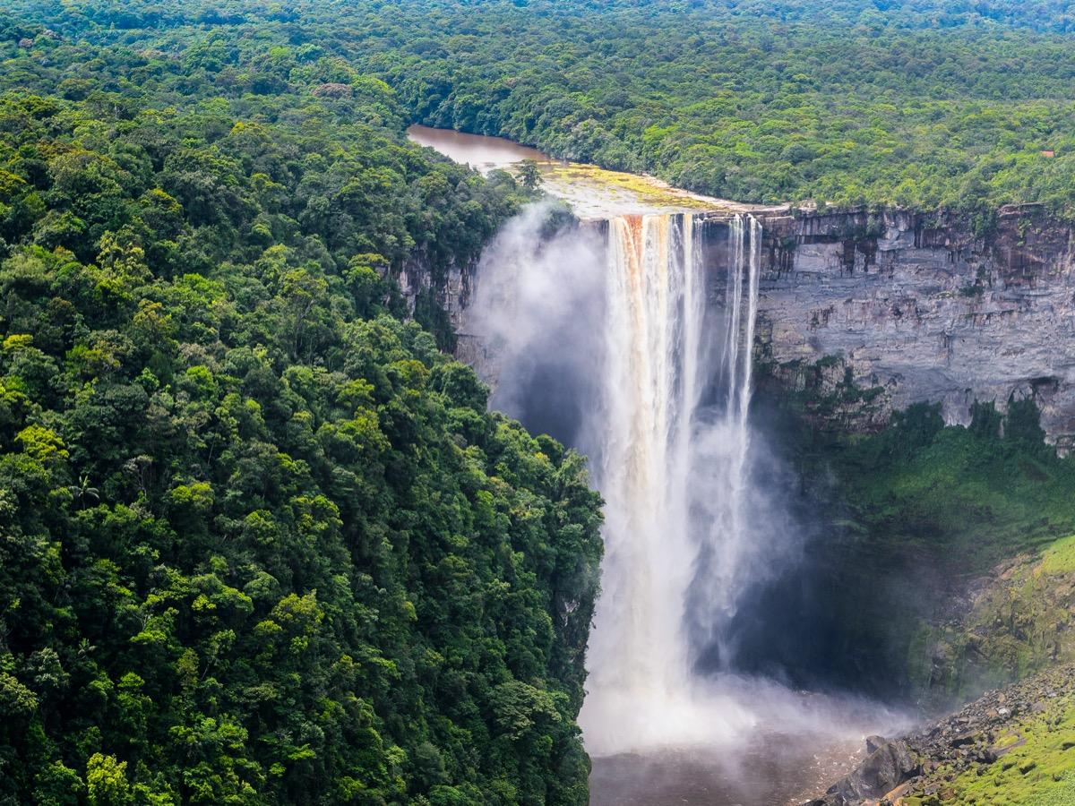 waterfall in lush rainforest in guyana
