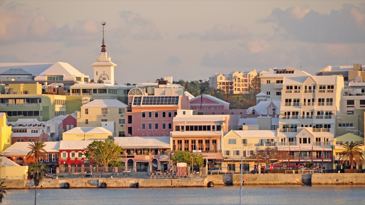 from the bay, a view of the capital city, Hamilton, Bermuda at sunset.