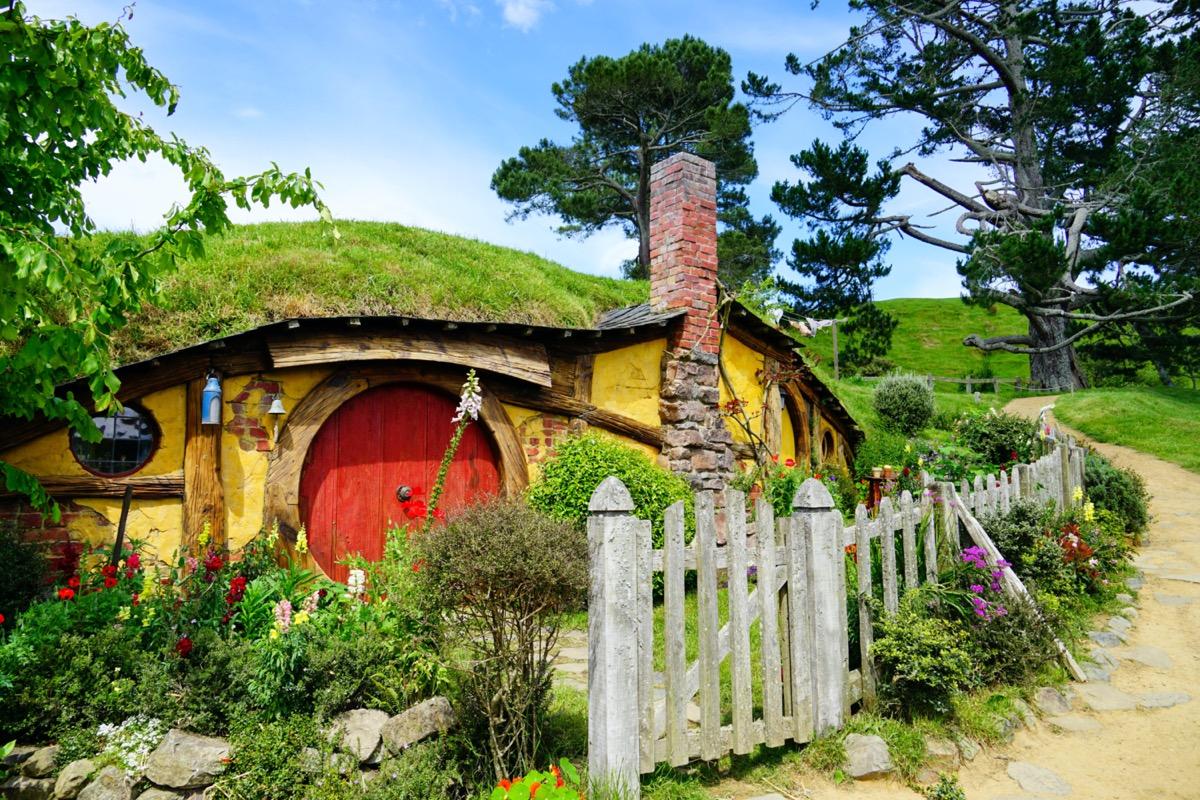 hobbit house in a hillside with a red door