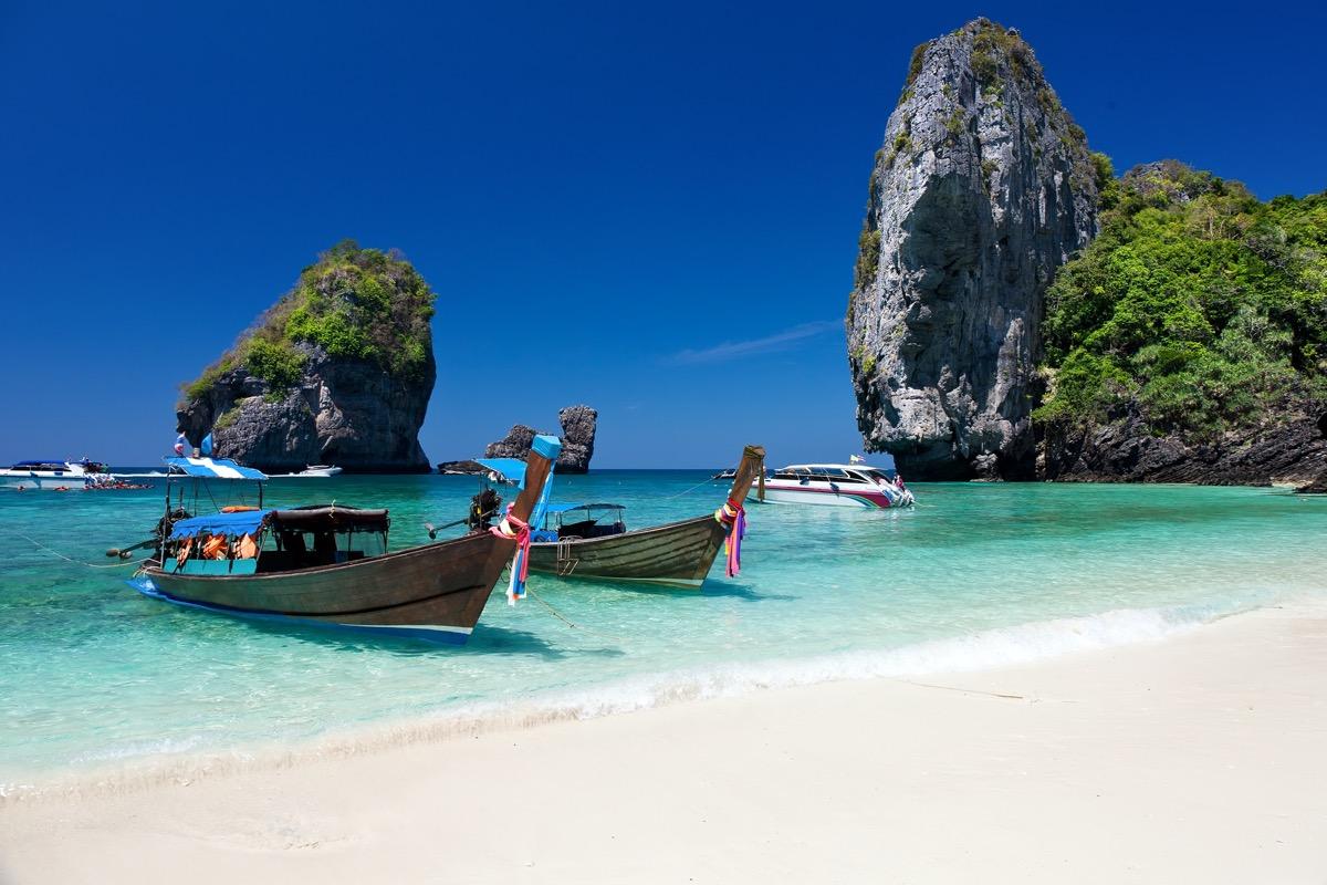 wooden boats on ko phi phi beach