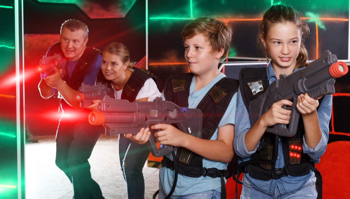 Family playing laser tag together