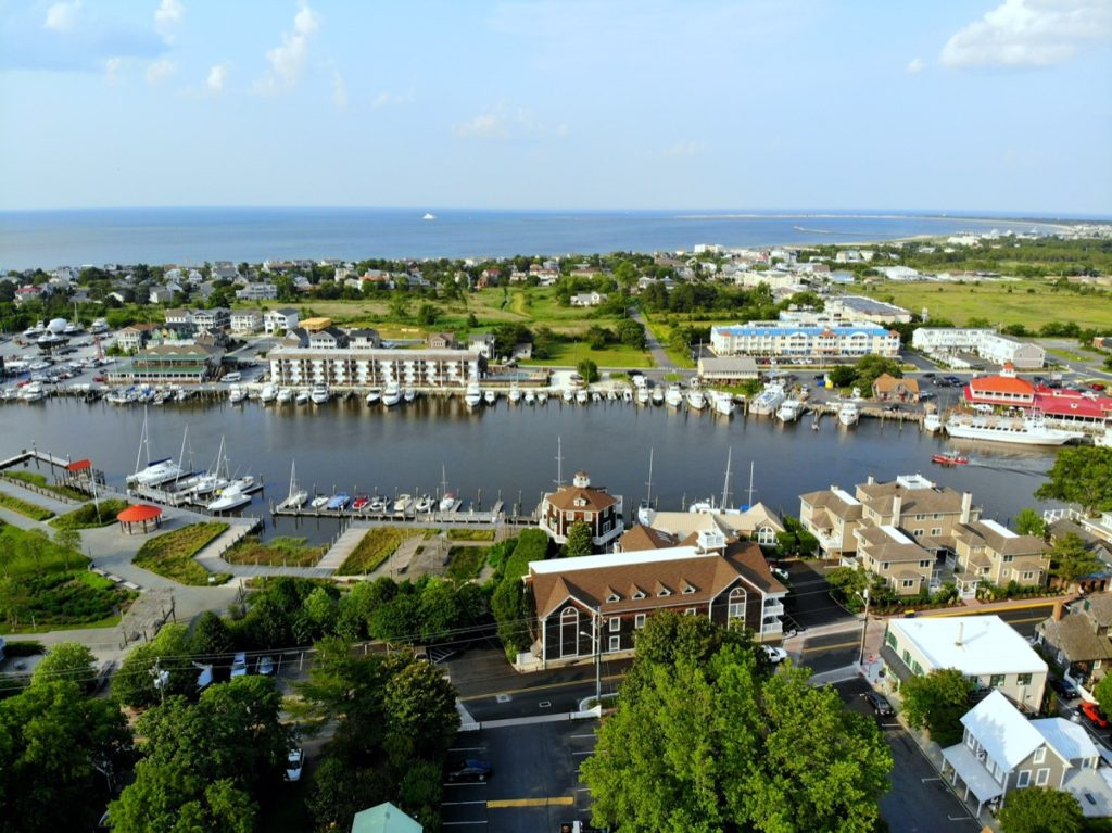 The aerial view of the beach town, fishing port and waterfront residential homes along the canal Lewes Delaware